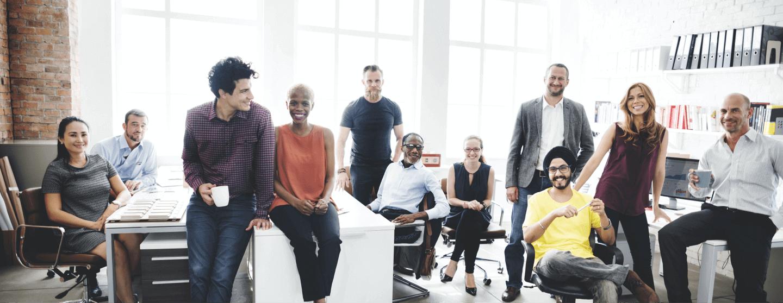 Coworkers smiling in meeting room