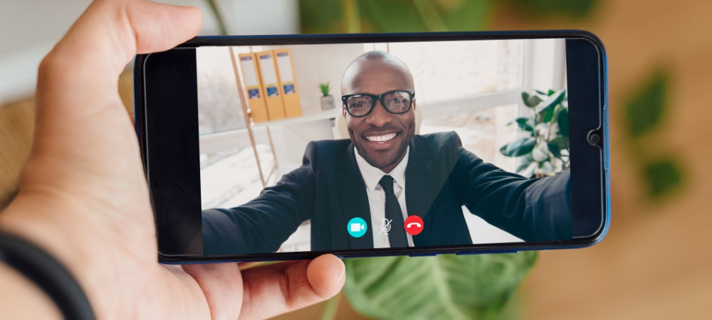 Man video conferencing via cell phone